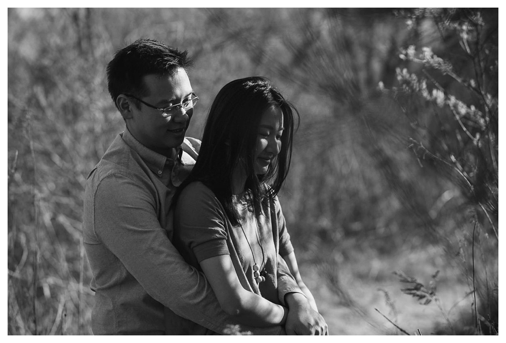 A loving engagement embrace caught in the memory of black and white.