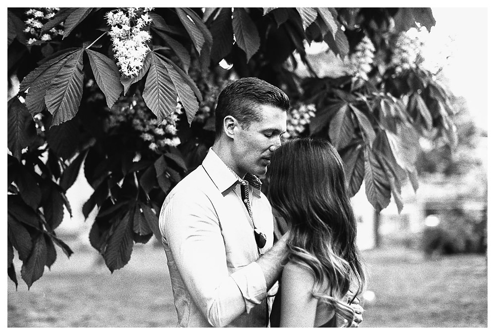 Love captured through a kiss on the engagement day.