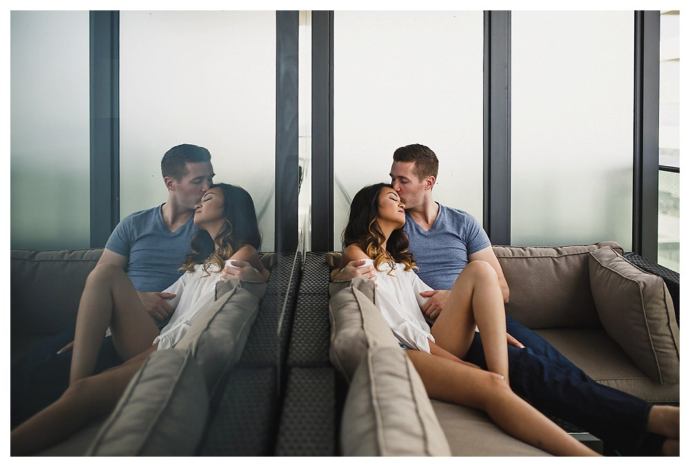 True love is reflected in the groom's kiss up high in the condo.