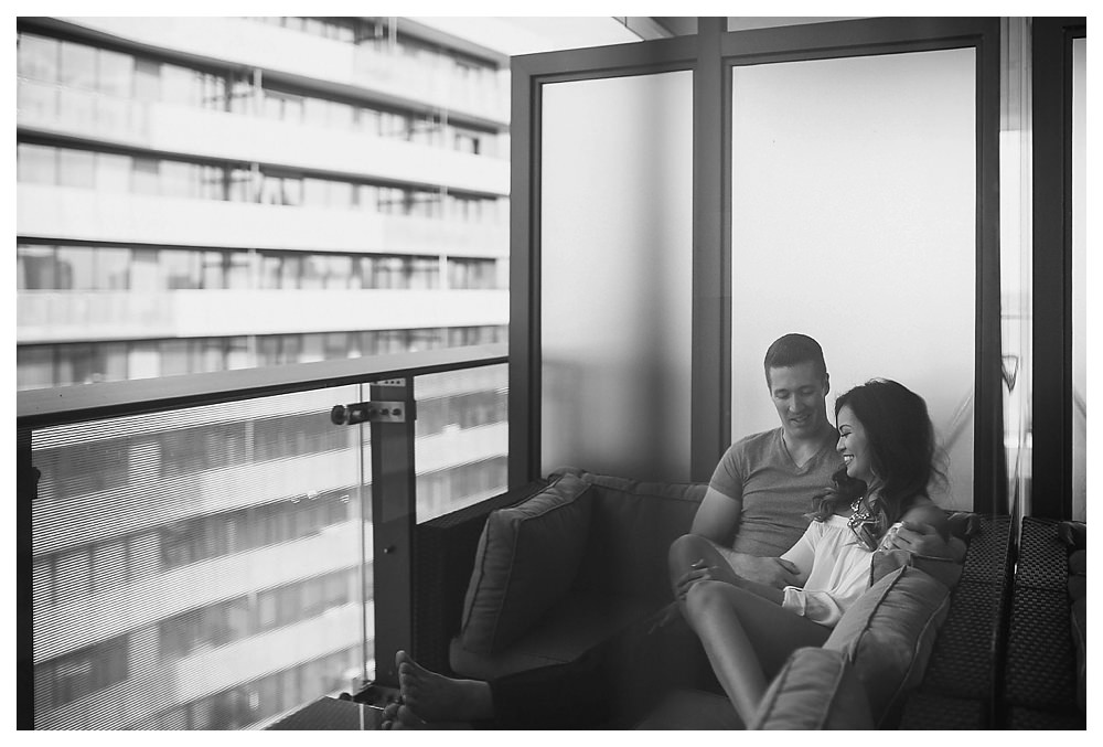 Engagement photos in Toronto begin in the comfort of the home high up on the balcony of their love.