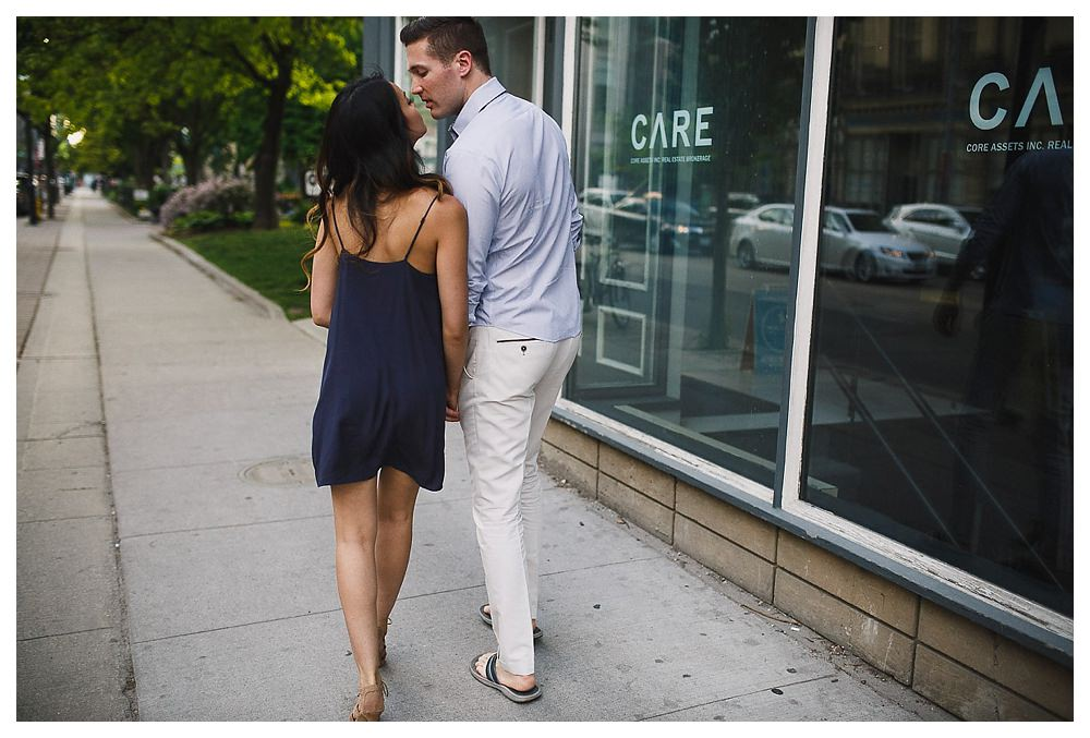 The loving care of bride and groom on the streets of Toronto.