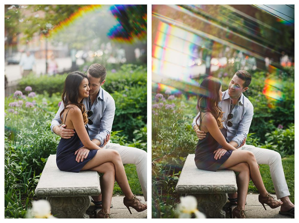 The sun bursts through the sky adding a special glow to the couple on the park bench for their engagement photo day.
