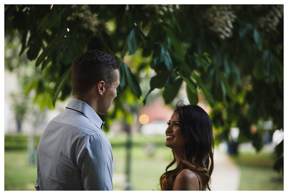Under the tree in the park of Toronto the smiles of the bride to be show all the love they feel.