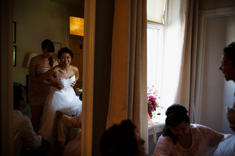 Bride getting dressed at Gladstone Hotel Toronto.