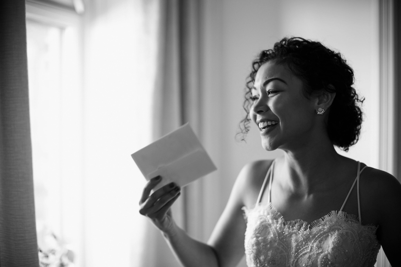 Toronto bride reading love letter at Gladstone Hotel.
