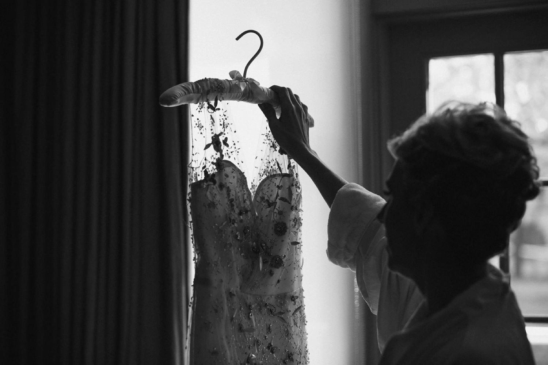 Bride looking at weding dress at The Ivy.
