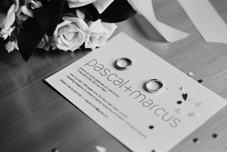 Wedding invitations and rings at Four Seasons Toronto.