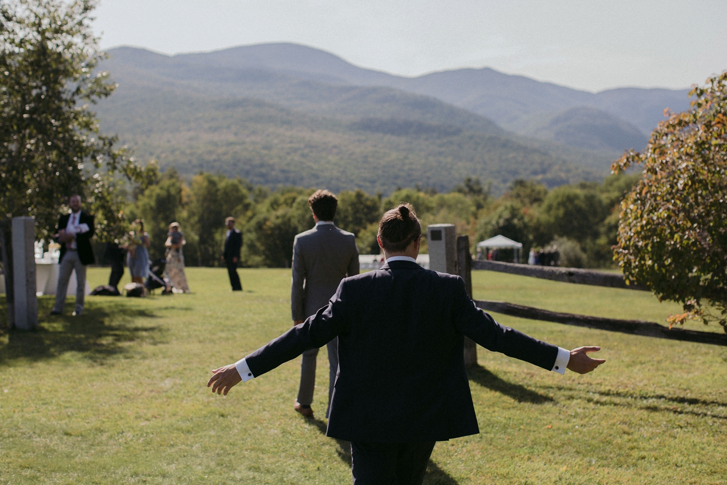 Groom entering ceremony meadow at Trapp Family Lodge wedding.