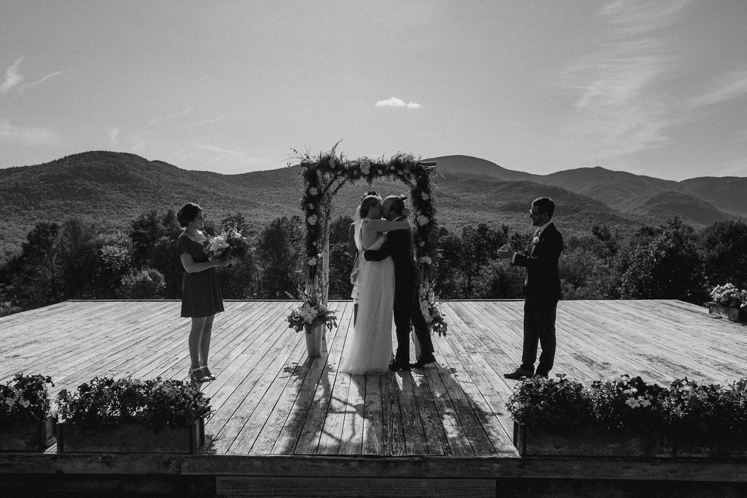Couple kiss during ceremony in Vermont wedding.