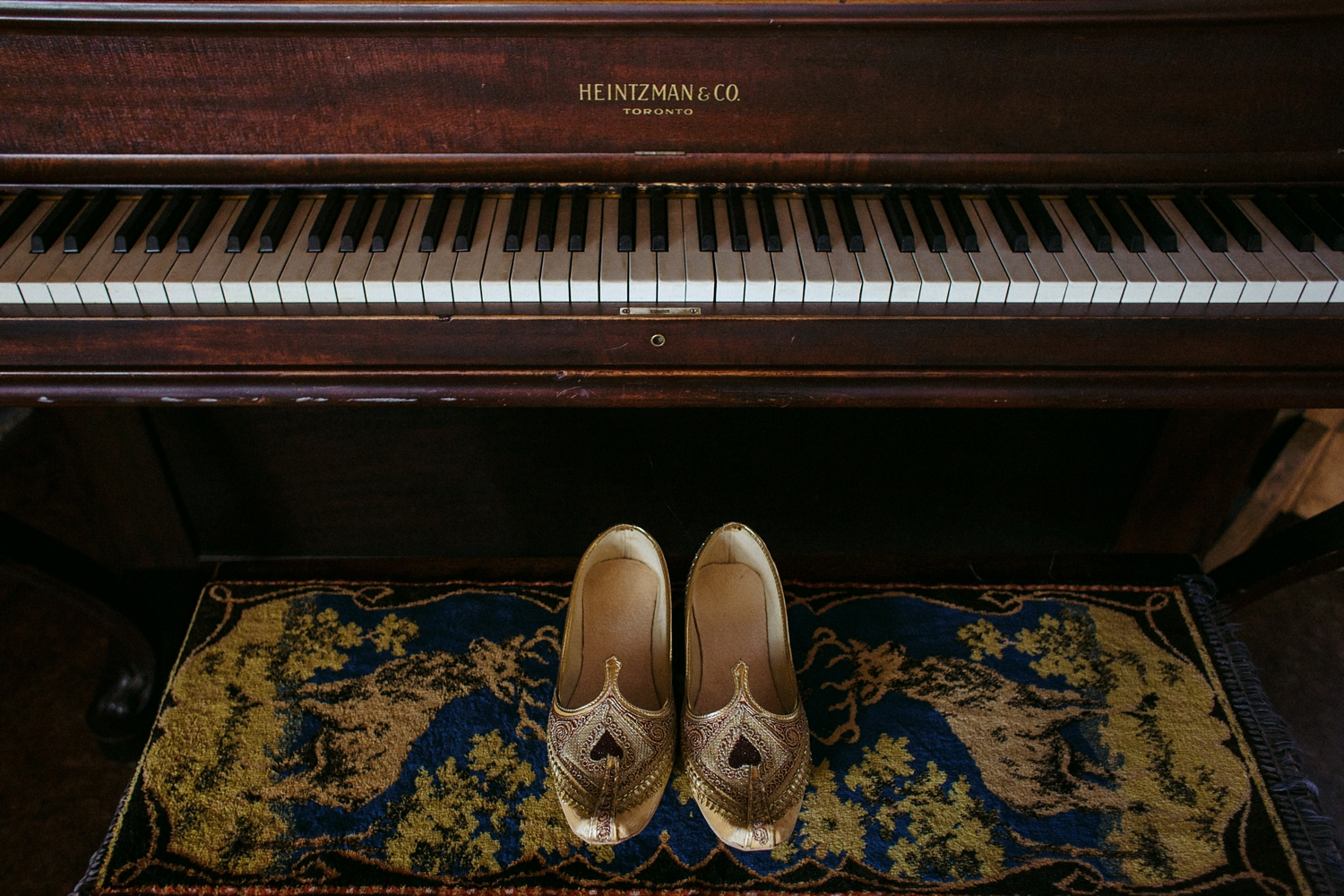 Indian groom shoes on piano bench in Toronto.