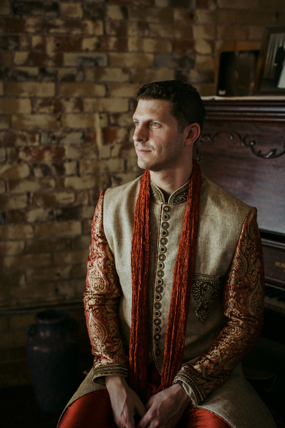 Groom in Indian wedding at Ben McNally bookstore.