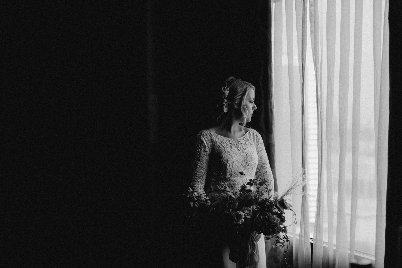 Bride looking at City Hall before wedding.
