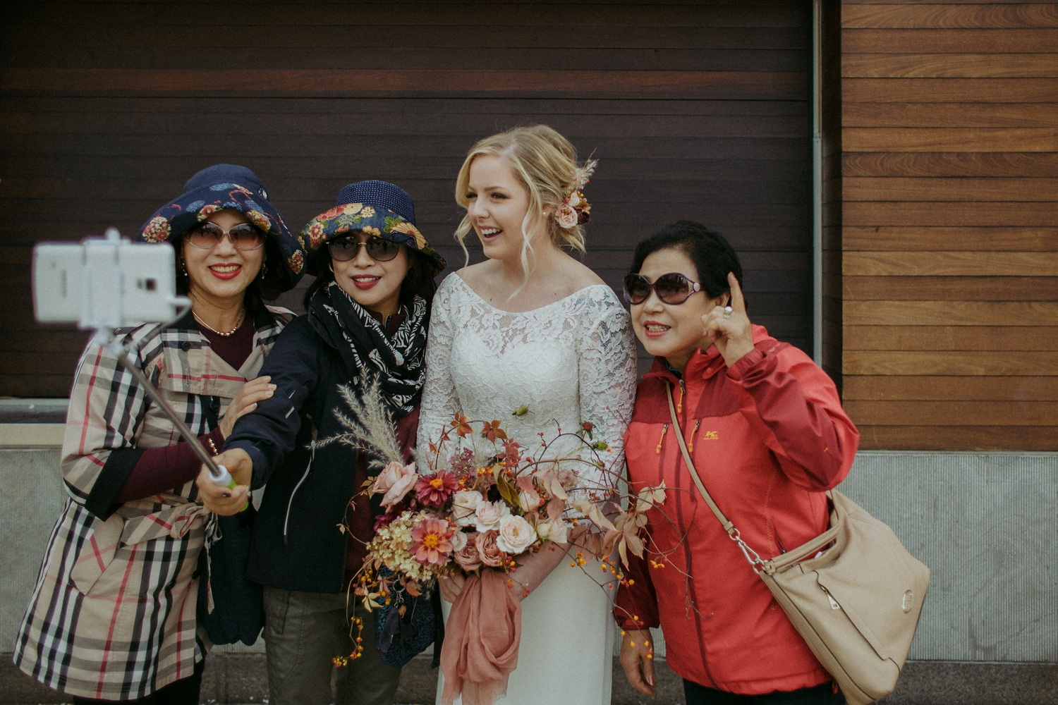 Bride and selfie stick outside of City Hall Toronto wedding.