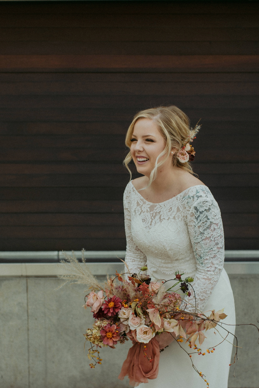 Bride and flowers at City Hall Toronto wedding.