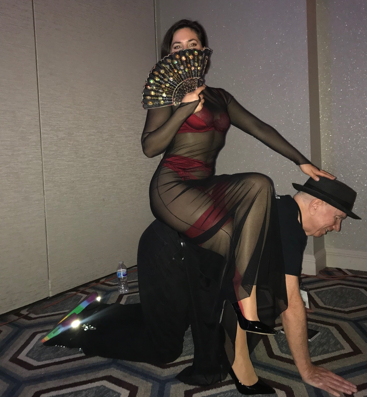 Using a slave as a chair at the DomCon social