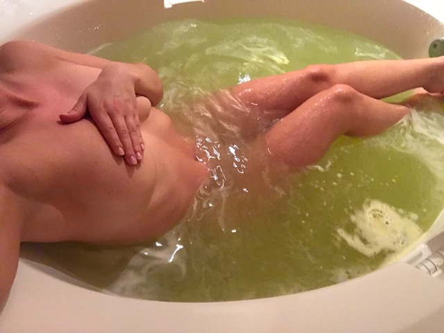 Soaking with a green bath bomb. I have a #bathfetish!