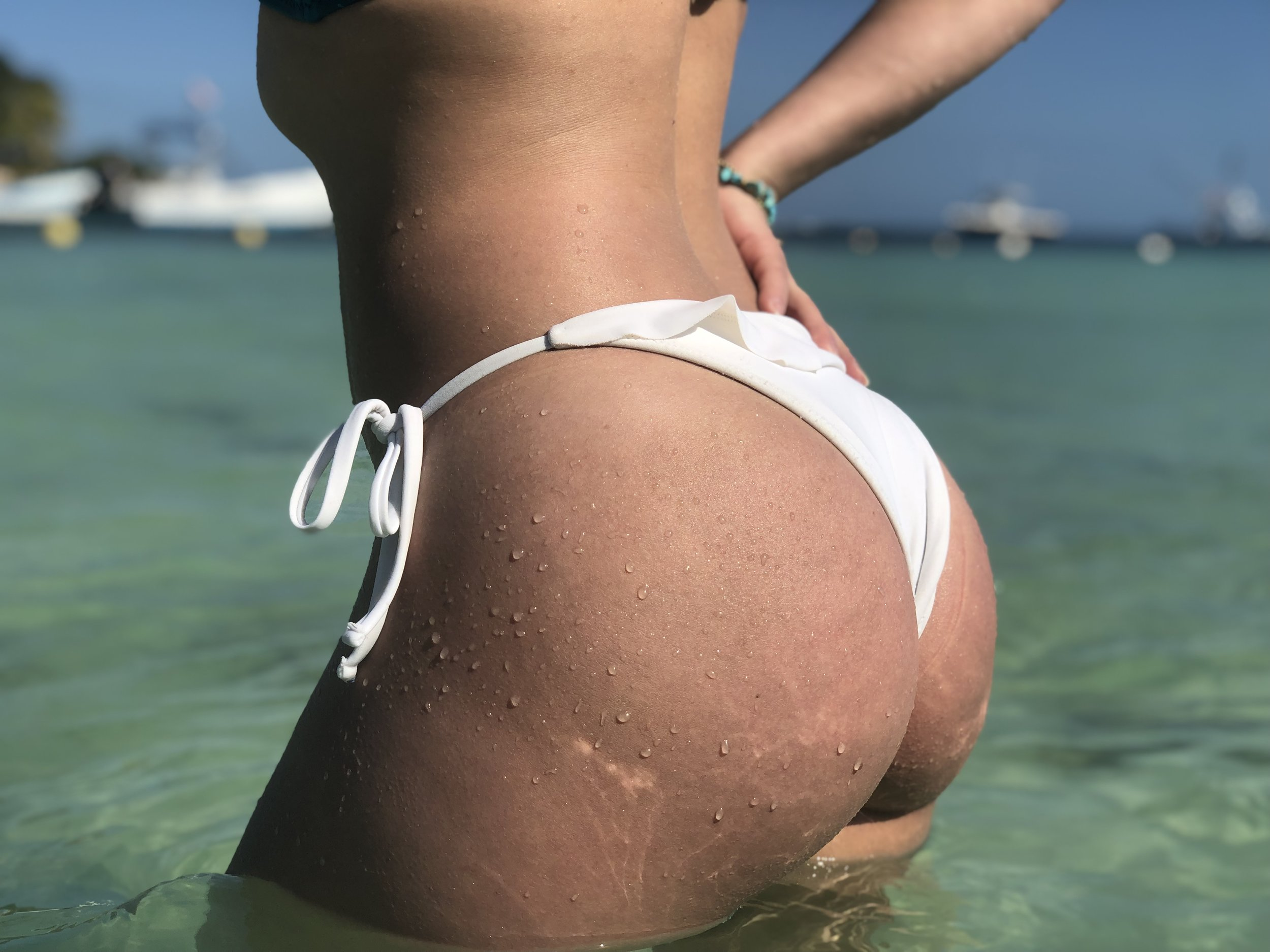 Getting sun on My booty while enjoying the Caribbean water