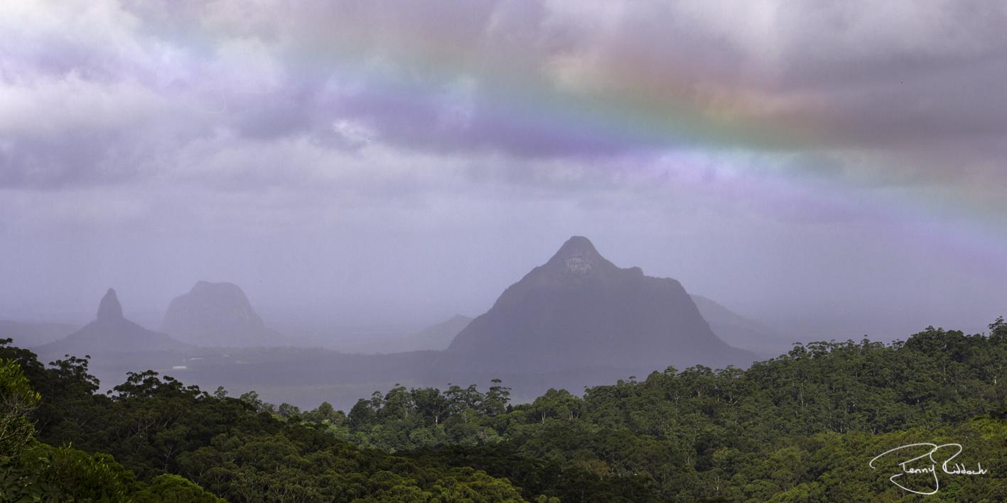 A Rainbow over Glasshouse Mountains Penny Riddoch.jpg