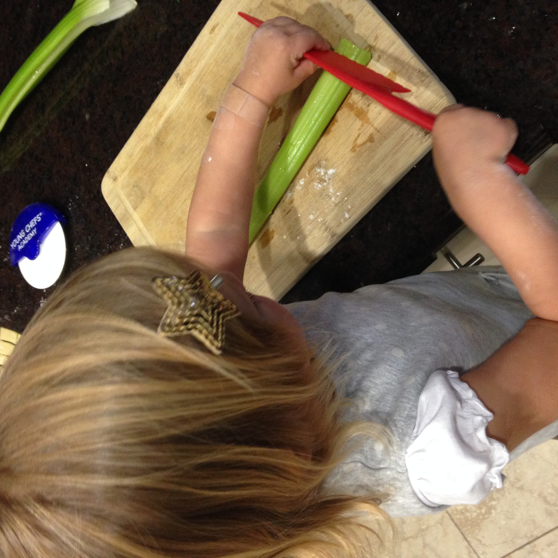 kiddo cutting celery