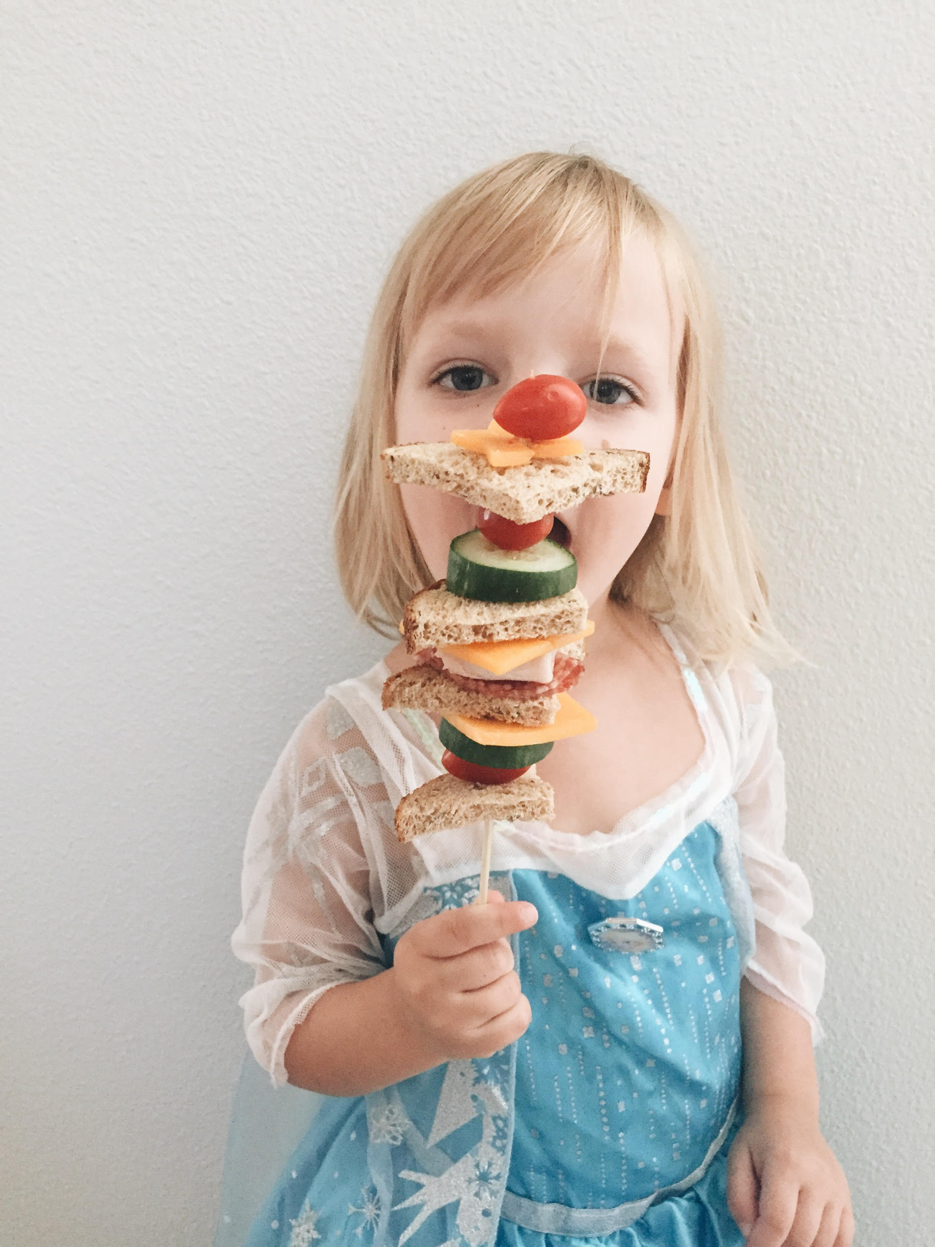 My little taste tester, Queen Elsa. When I got home from work her and Nana were very busy with a costume parade but she immediately stopped to try out this sandwich. It's a winner!