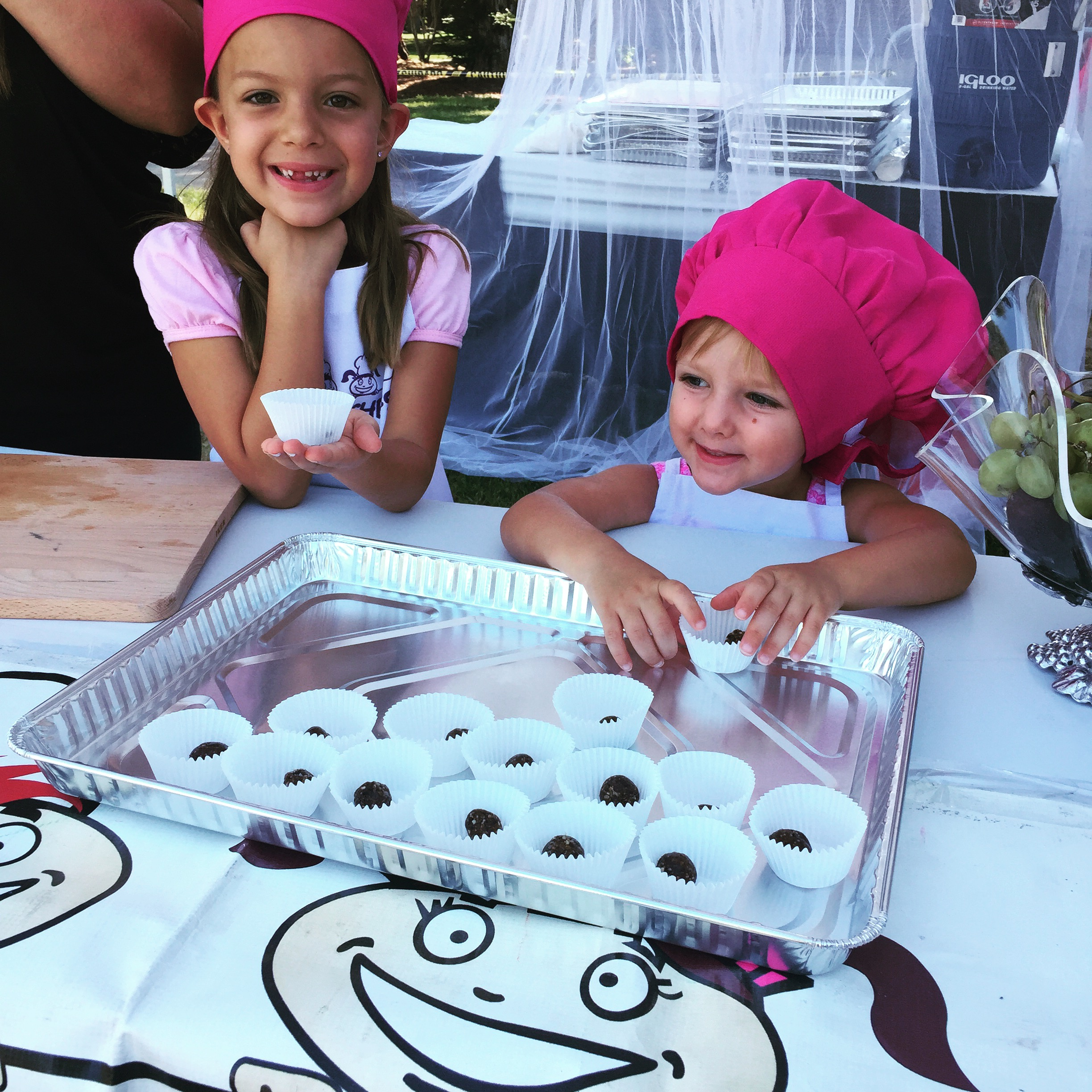 Alexandria (3) and Kinsey (6), passing out Fig Bites to almost 1000 attendees.