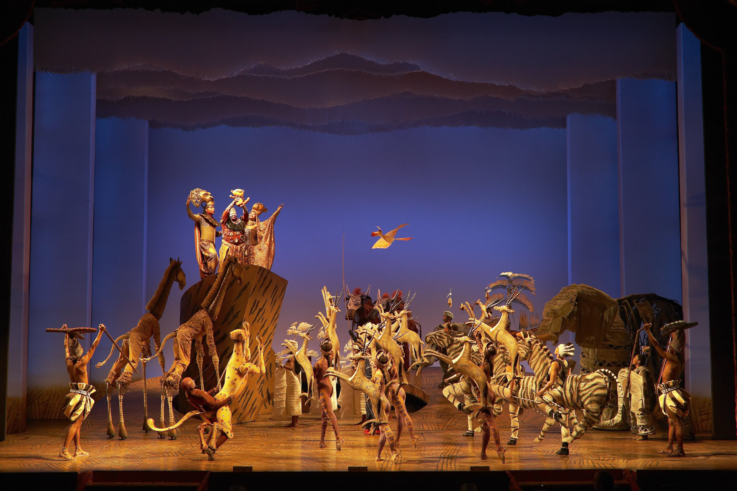 The Lion King - Scene of the Circle of Life summoning the animals of the Pride Lands for the presentation of baby Simba.