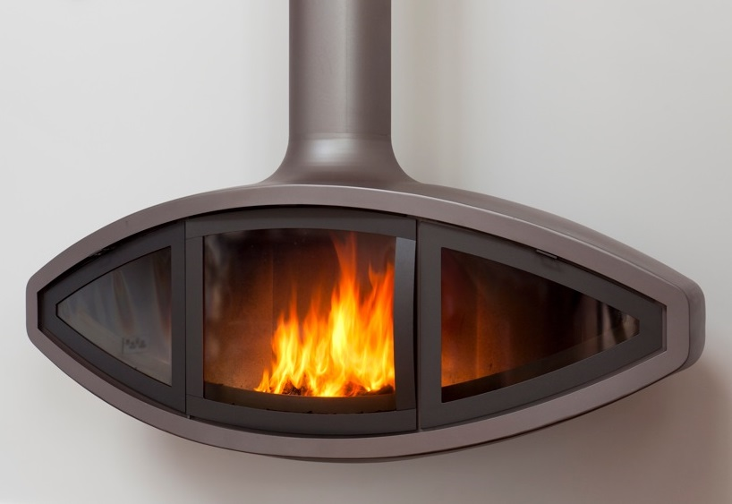 Our EyeFire suspended stove has three glass front panels, the central one of which is a side-opening door, which encloses the fire and offering greater efficiency and air control.