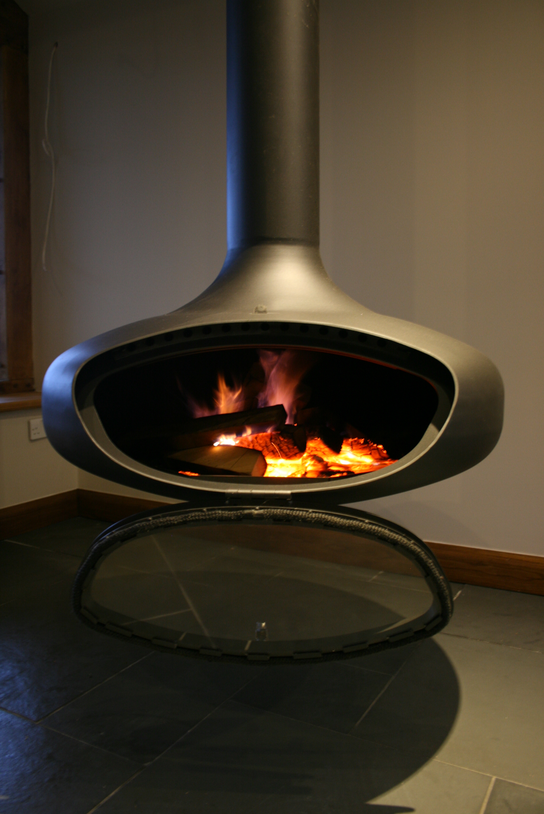 RObert Woods' Firebob suspended stove lit with door open.
