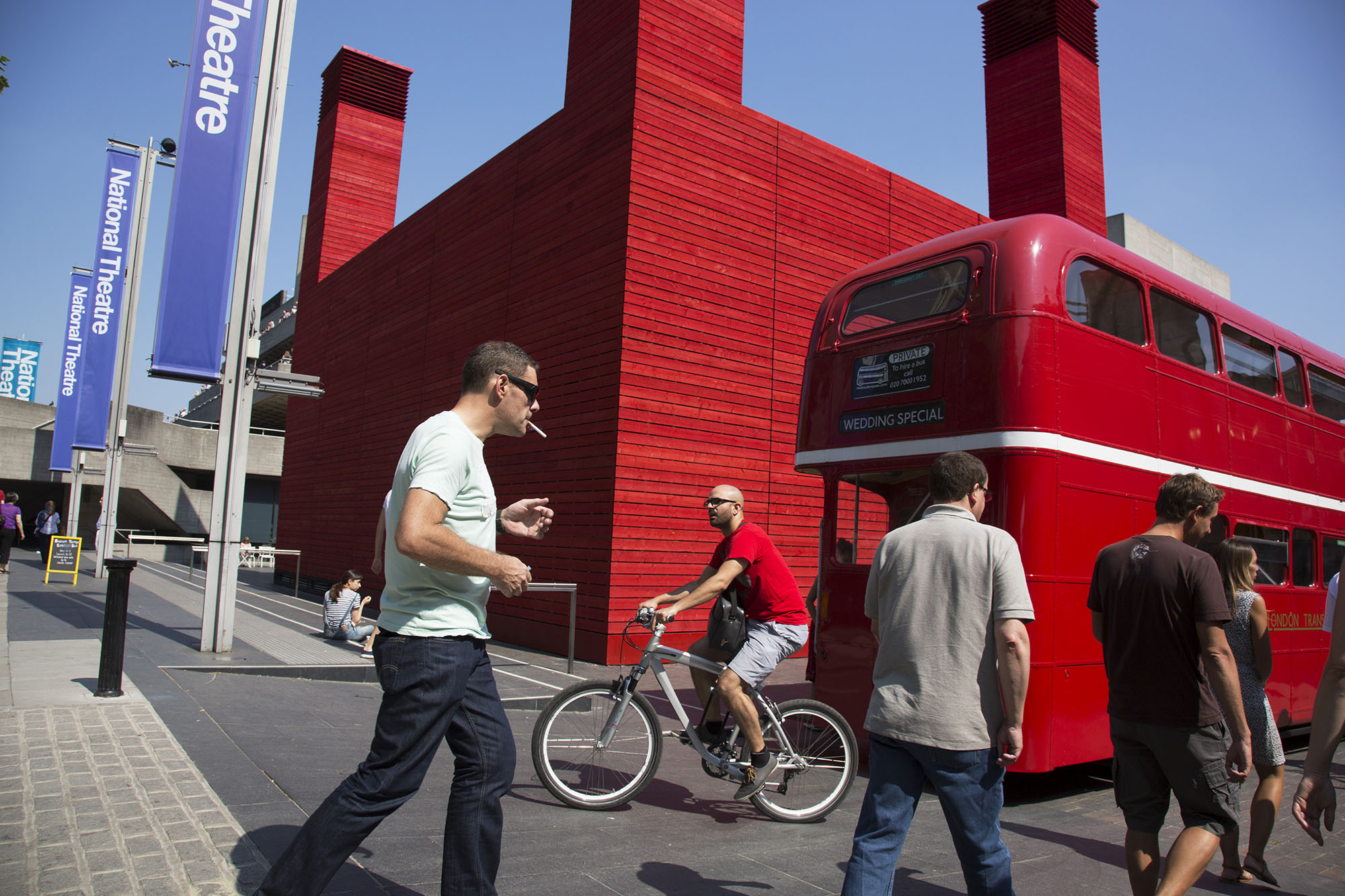 Red Routemaster parked outside the National Theatre's temporary space The Shed Theatre.