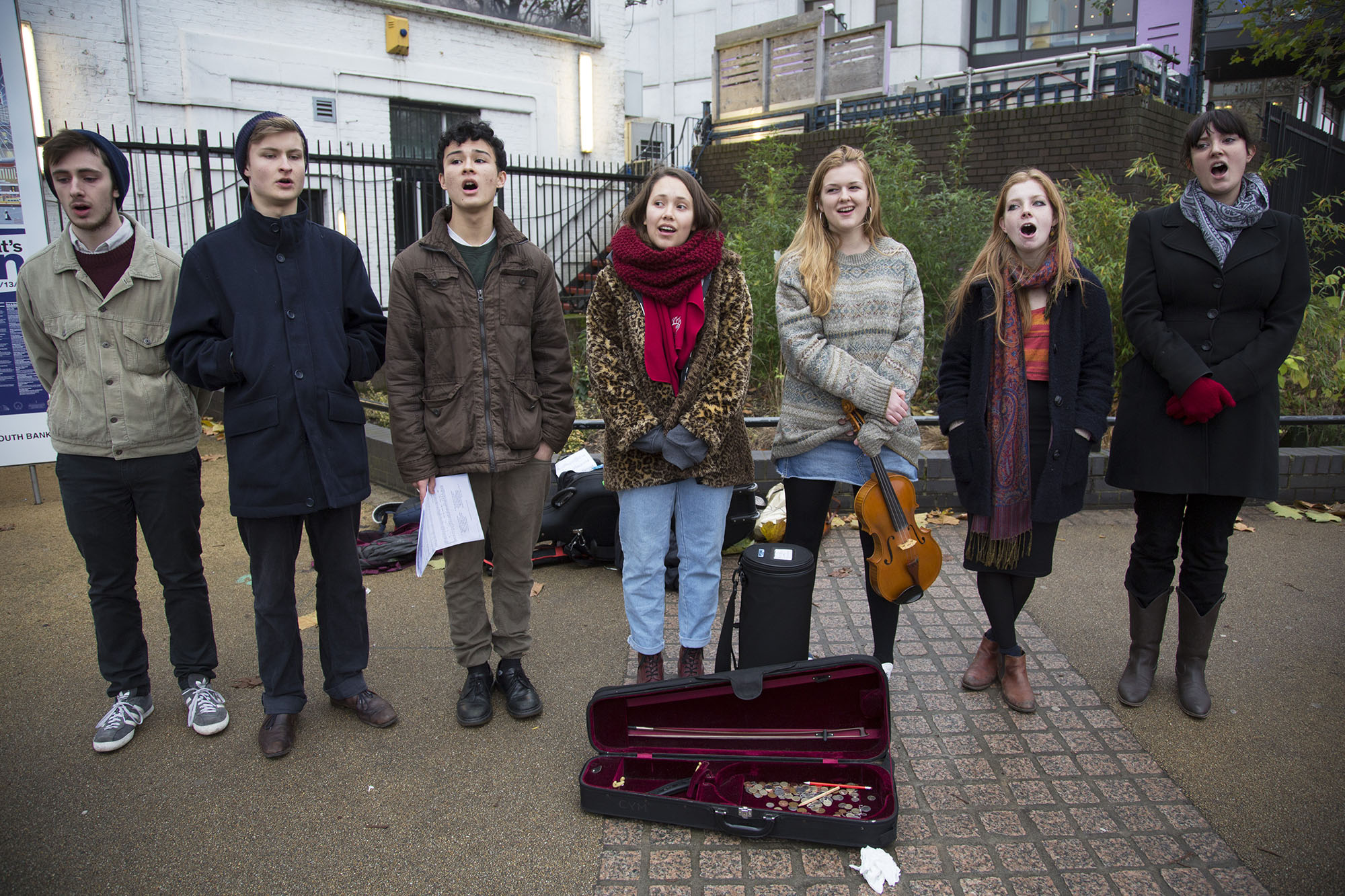 Young student Christmas carol singers busking on the South Bank.