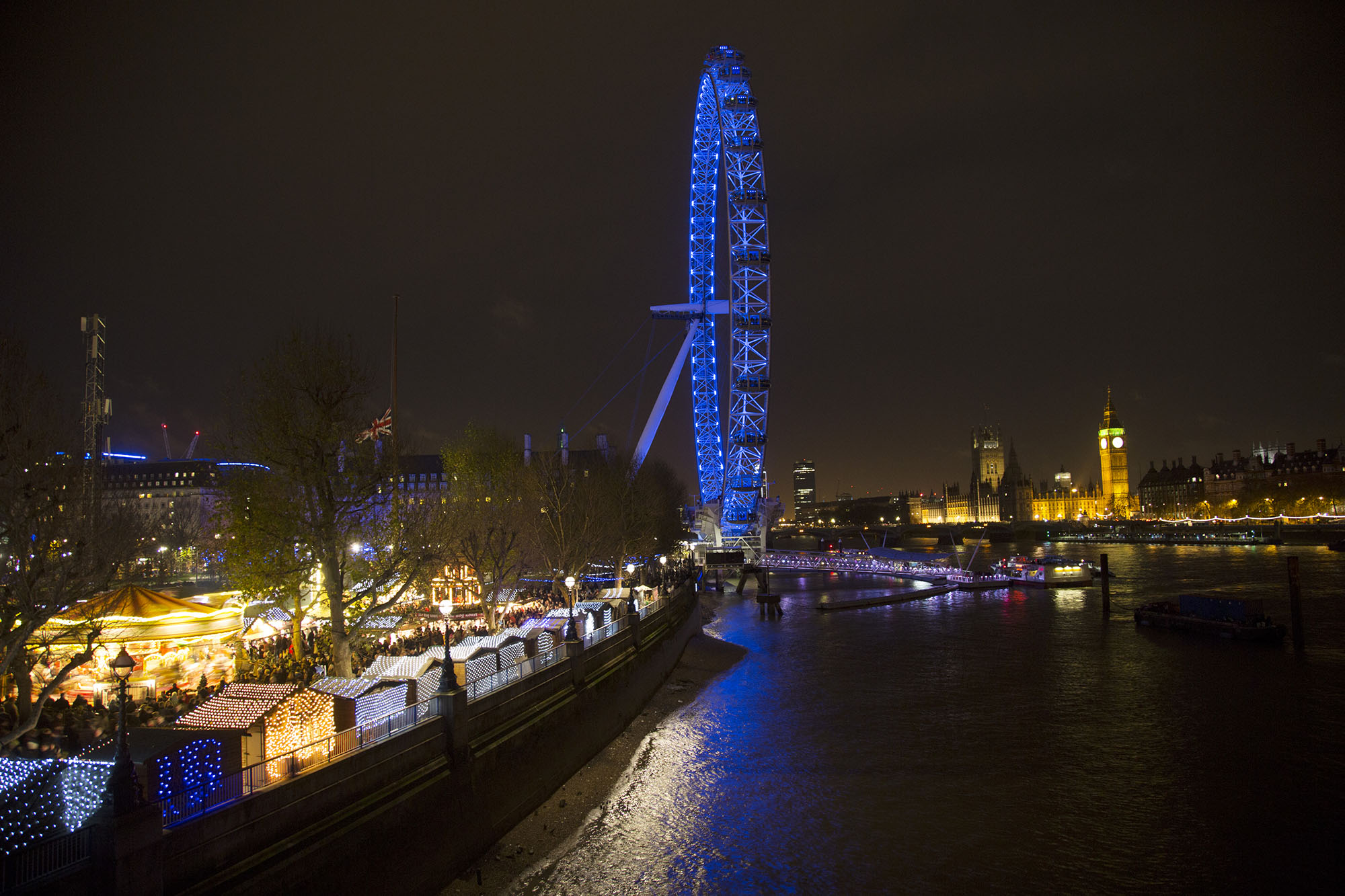 View during the Christmas season, towards the London Eye and Westminster across the River Thames.