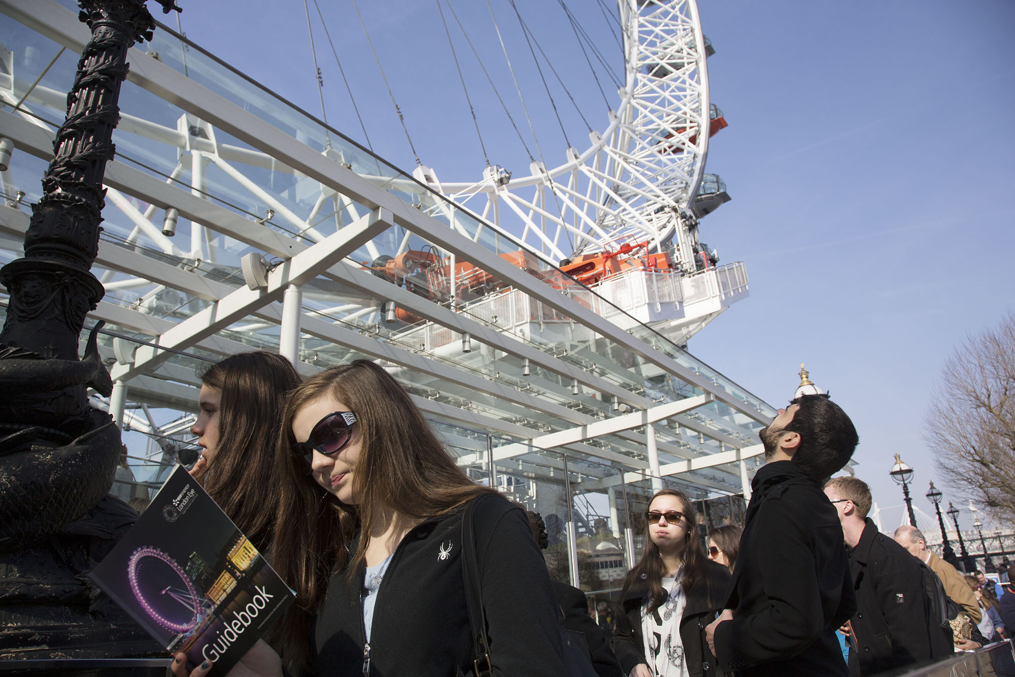 Tourists queue for the London Eye.