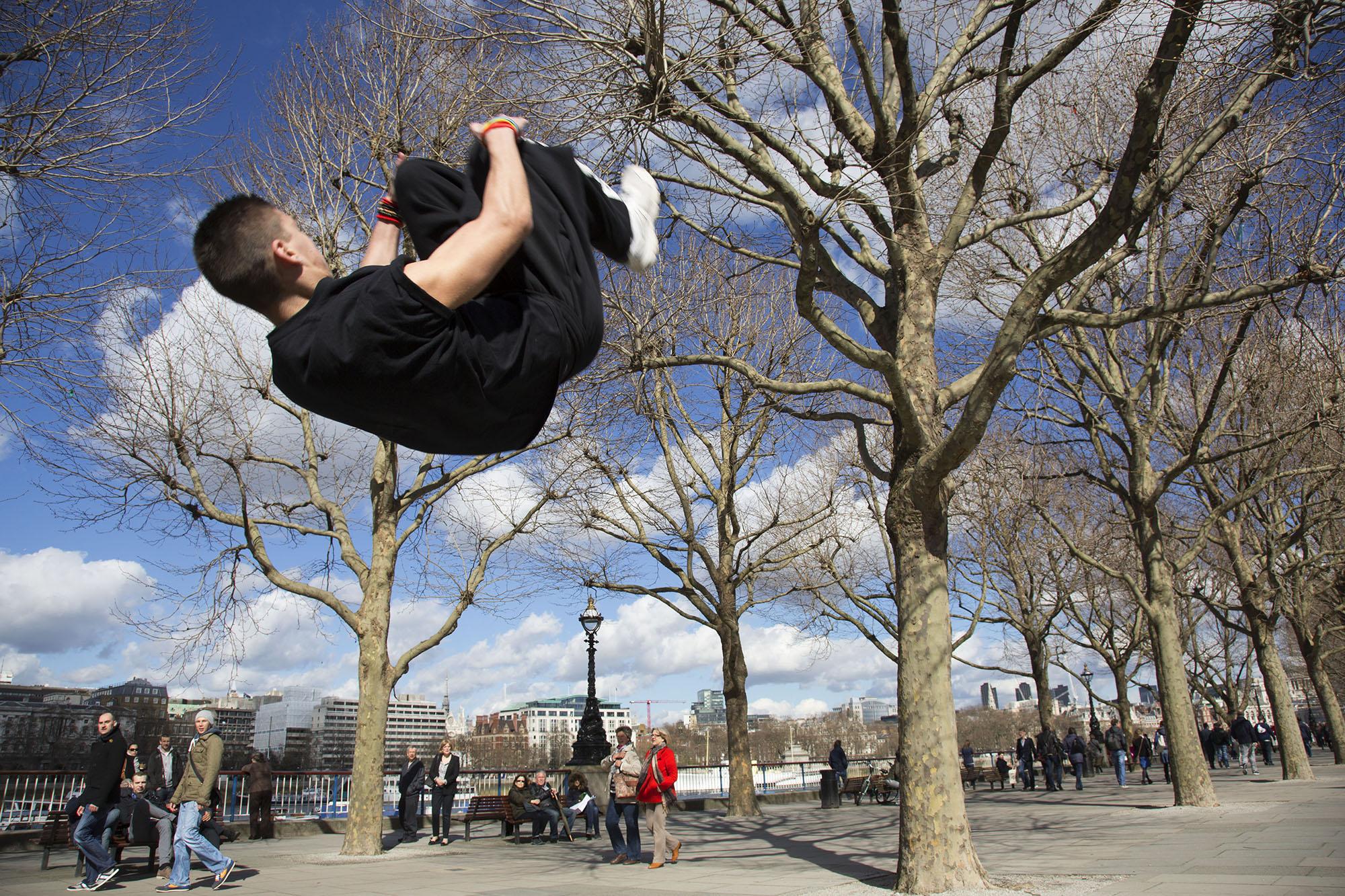 Parkour runner shows urban acrobatic skills.
