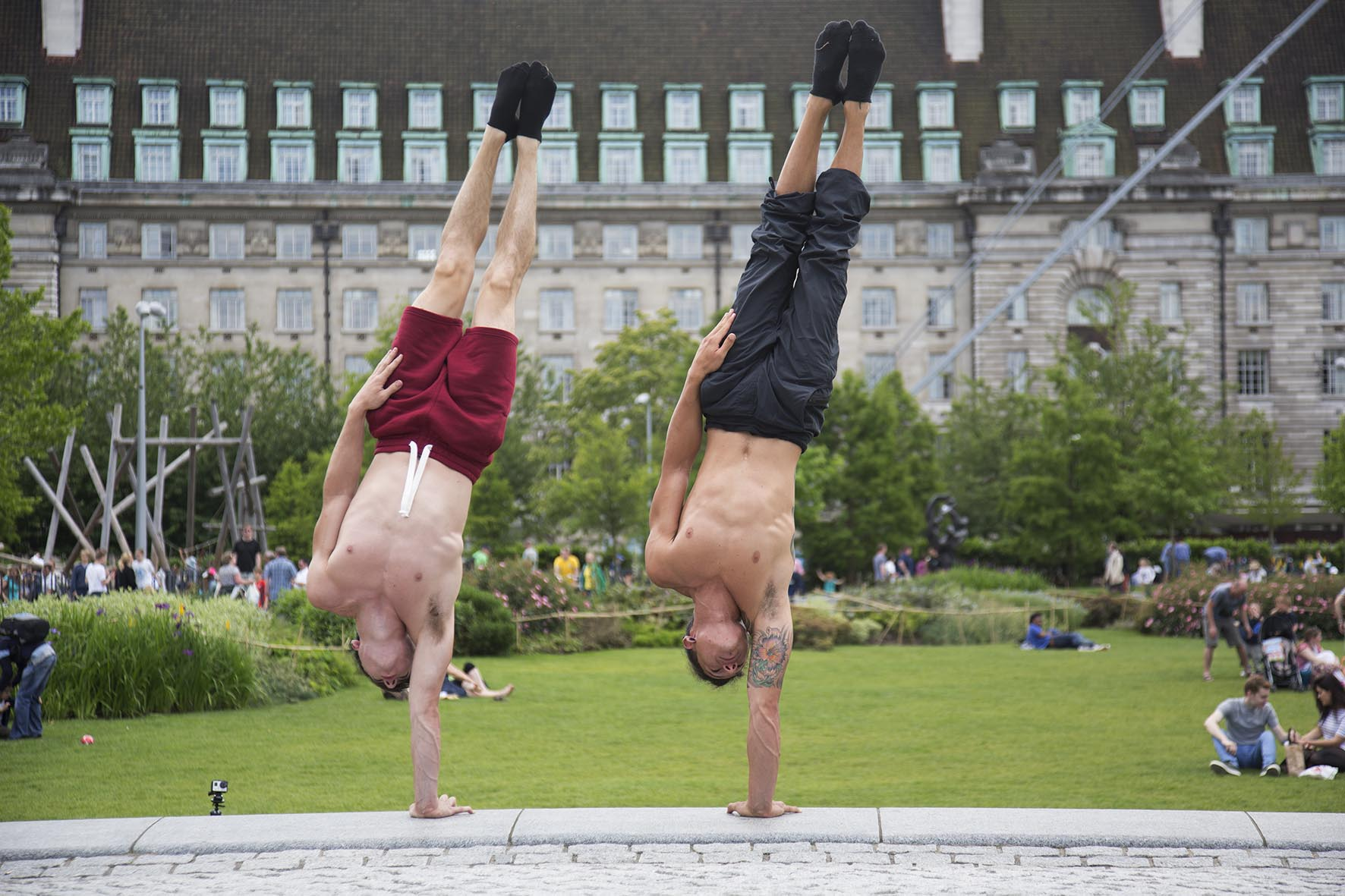 Daniel and Miguel, acrobats from Gravity & Other Myths Circus.