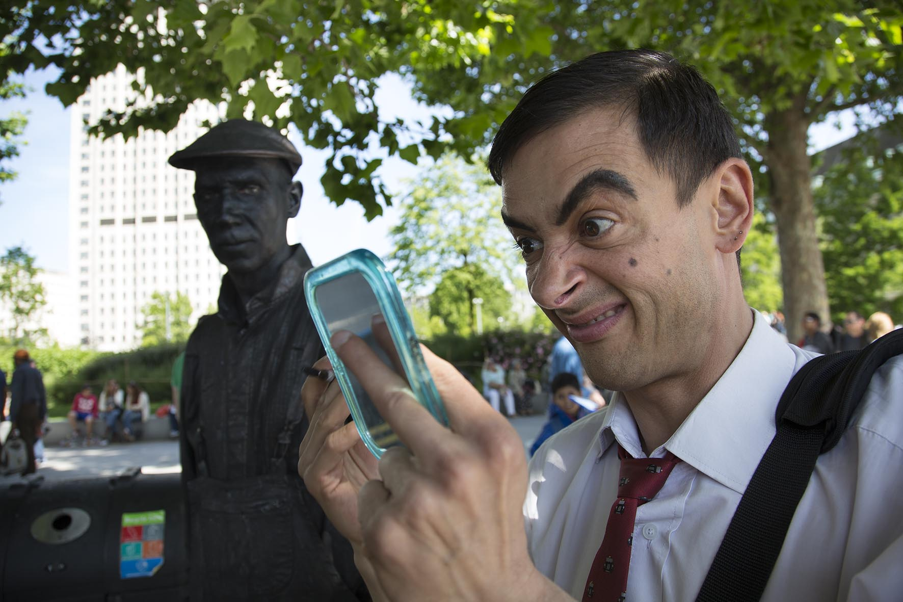 Mr Bean street performer makes some repairs to his make up.