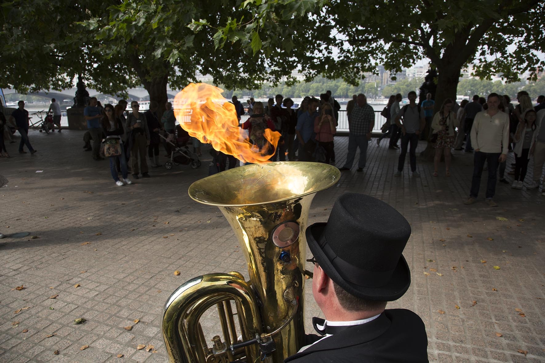 Christopher Werkowicz playing a tuba which shoots out flames.