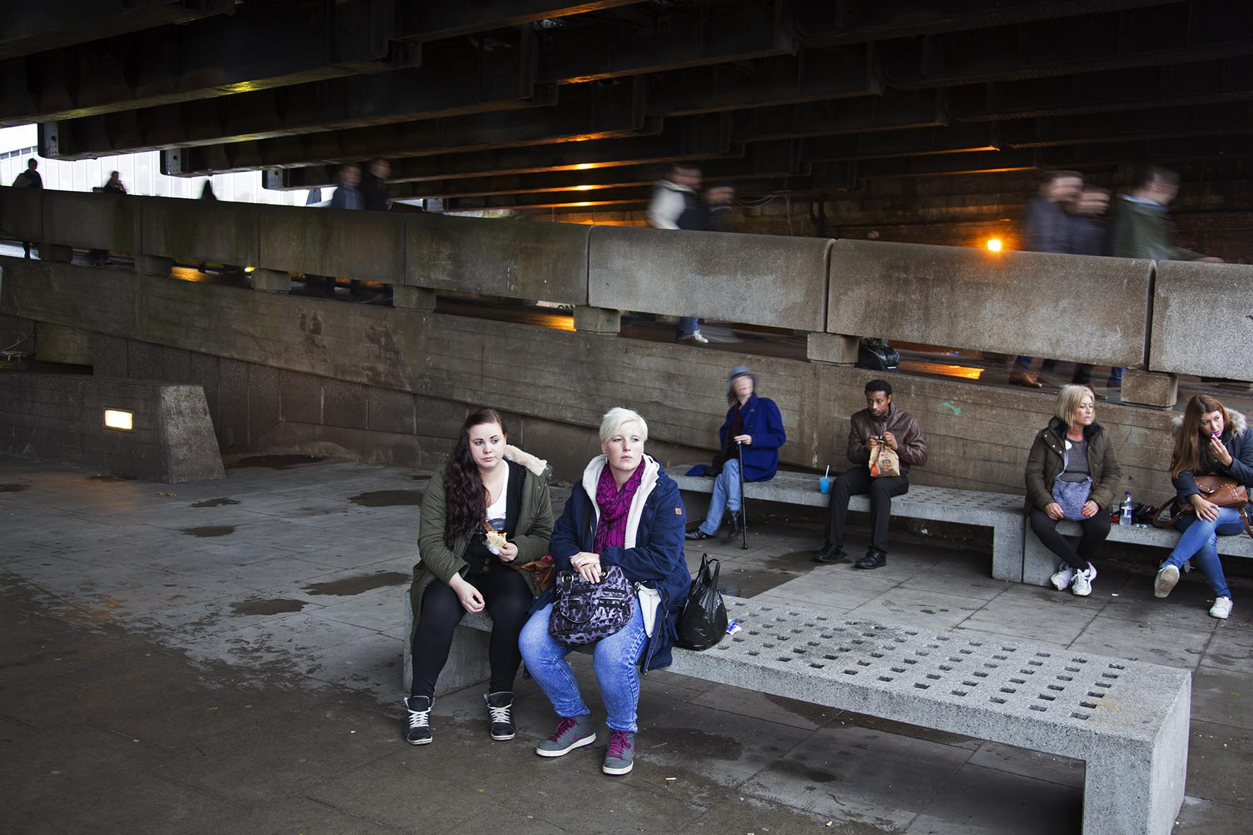Sheltering from the rain underneath Hungerford Bridge.