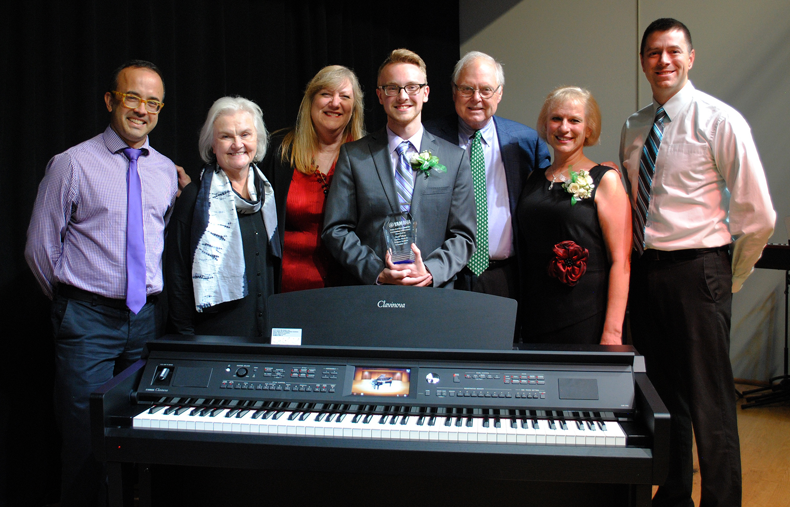 L to R: Derek Polischuk, MSU associate professor of piano; Deborah Moriarty, MSU piano professor; Lori Frazer, PROGRAM SPECIALIST, Yamaha Music and Wellness Institute; Kalil Olsen; Merritt Lutz; Ann Olsen; Jimmy Edwards, president, Marshall Music.