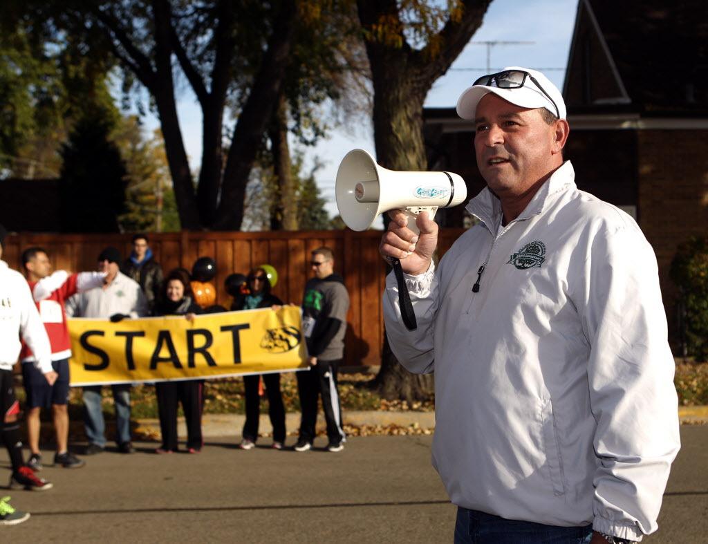 "Mayor Angelo ""Skip"" Saviano starts the 5K Tiger Tear Run/Walk at Elmwood Park High School Sunday Oct. 19, 2014. | Kevin Tanaka/For Sun-Times Media   (Click photo to read story)"