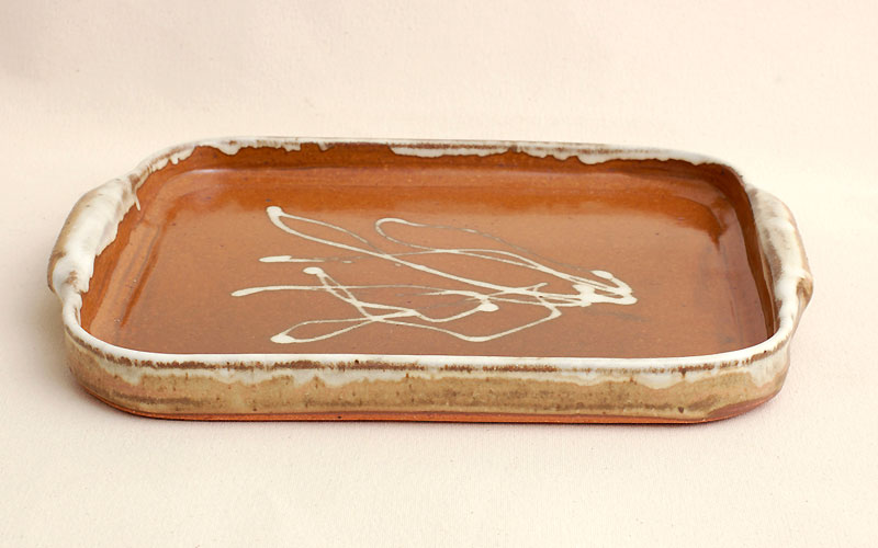 Baking Sheet/Serving Tray is 11-1/2 inches x 12 inches and 1 inch high. Also use for broiling.