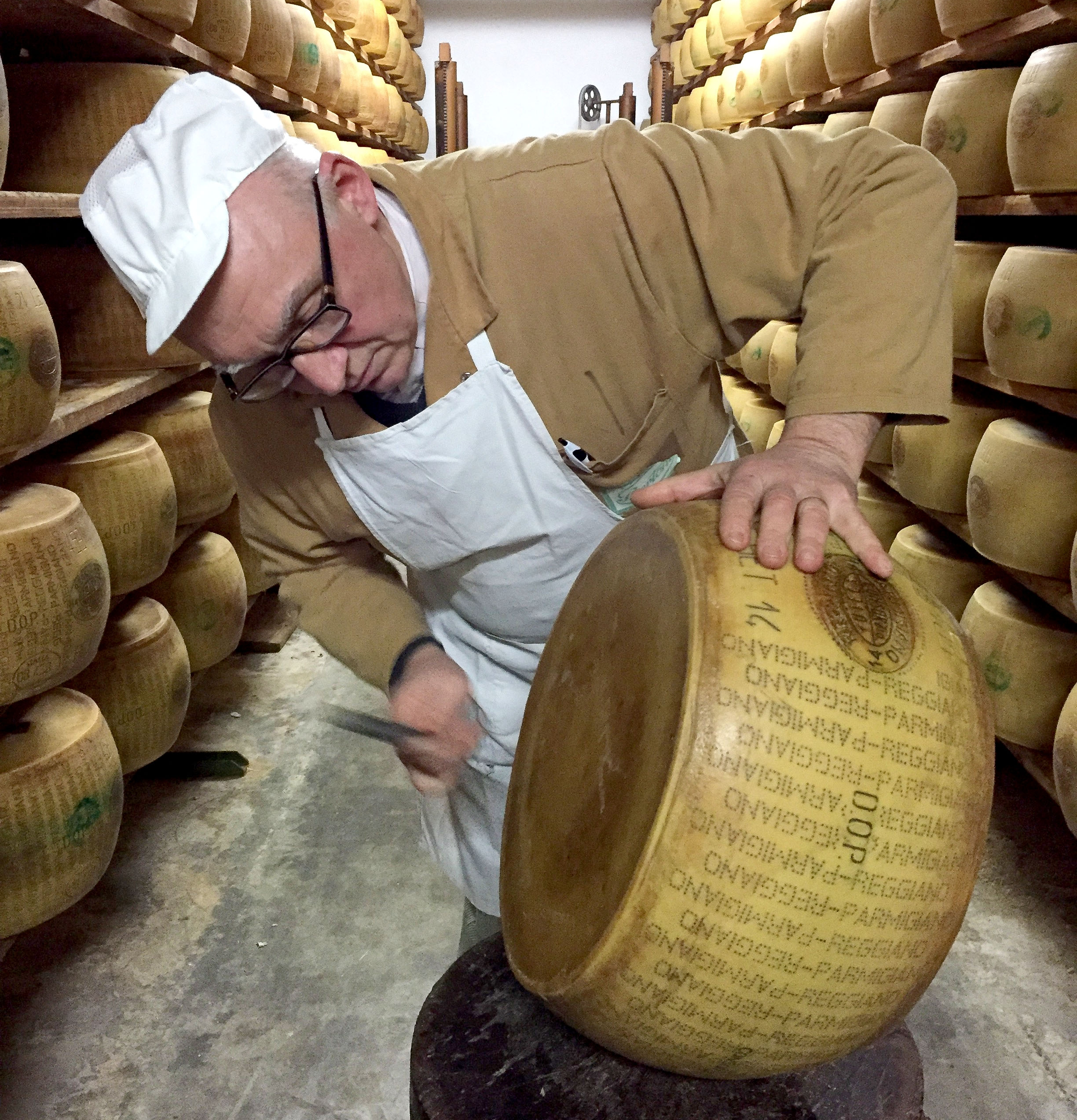 Hammering Parmigiano-Reggiano. Photo: Patricia Michelson.