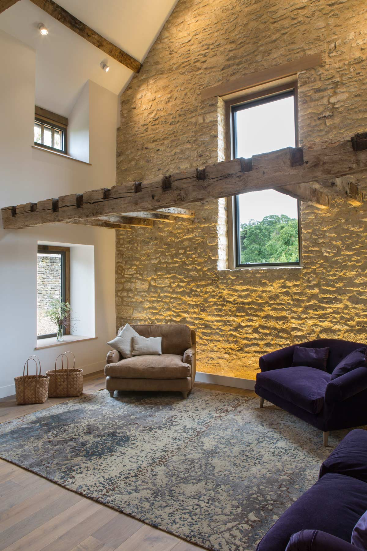 barn-conversion-cotswold-stone-wall-wash-lighting-rogue-designs.jpg
