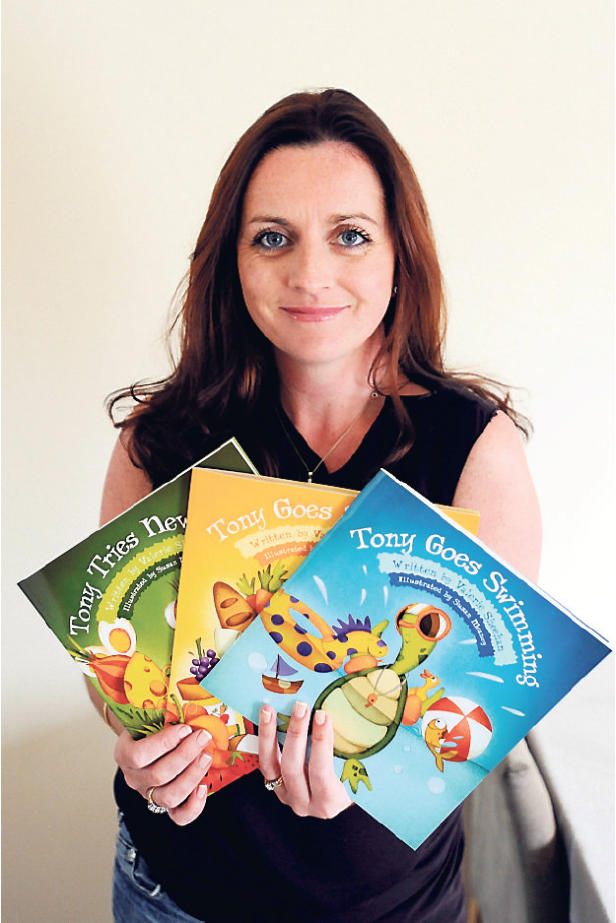 Book aids: Valerie Sheehan with her self-published range of children's books, featuring Tony the turtle and his family. Picture: Denis Scannell