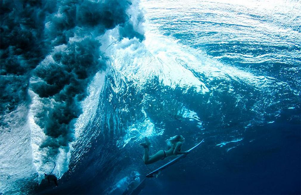 Female-Surfers-as-they-plunge-beneath-the-Ocean-Waves-5.jpg