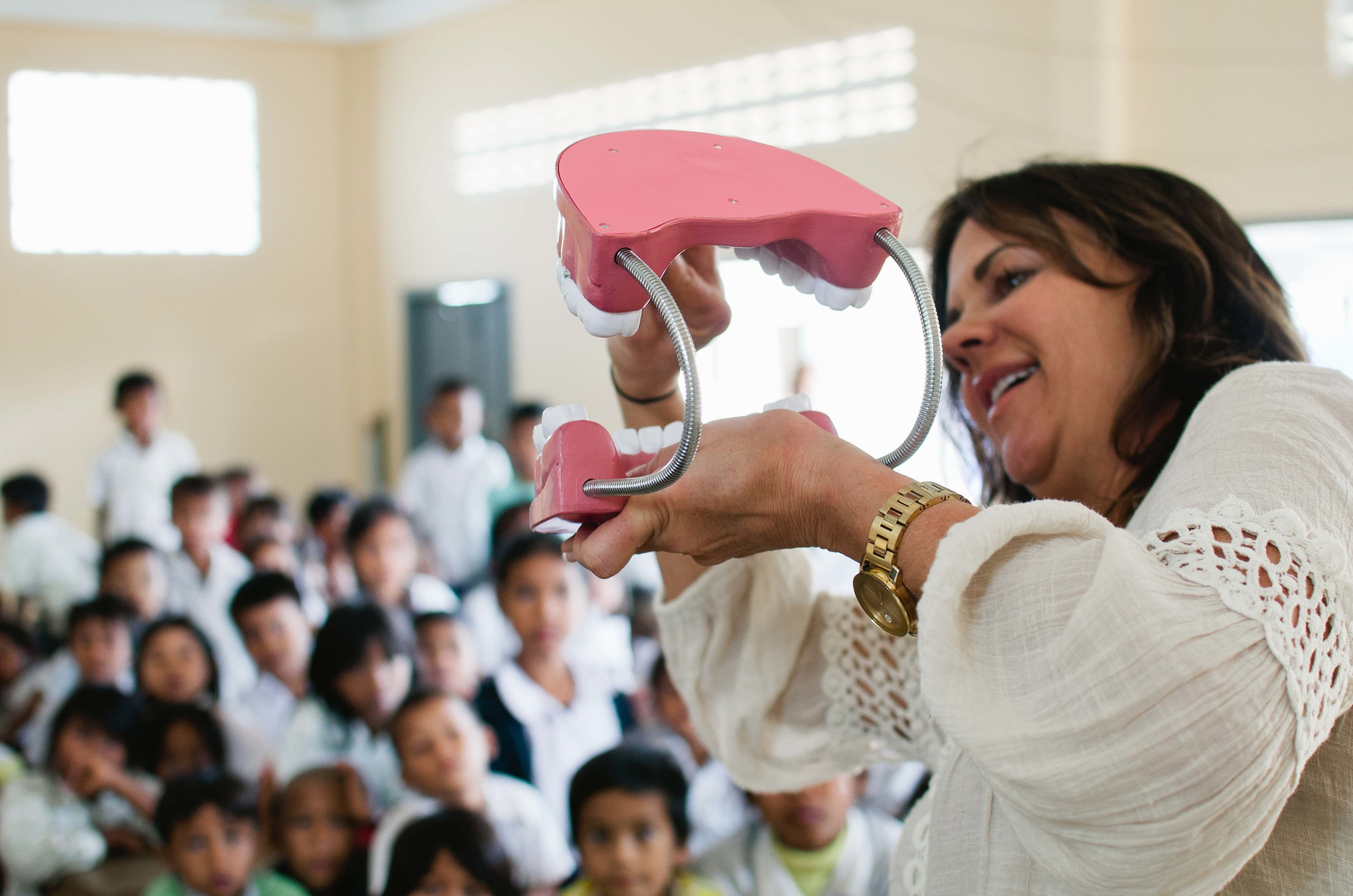 Team-member, Sharon Dunnigan, using the 'big mouth' to teach our village kids about oral hygiene!