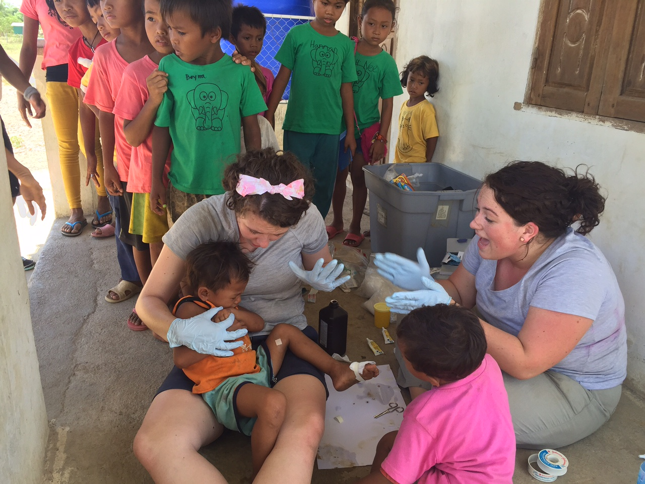 Madeline & Molly treating kids at our makeshift medical clinic.