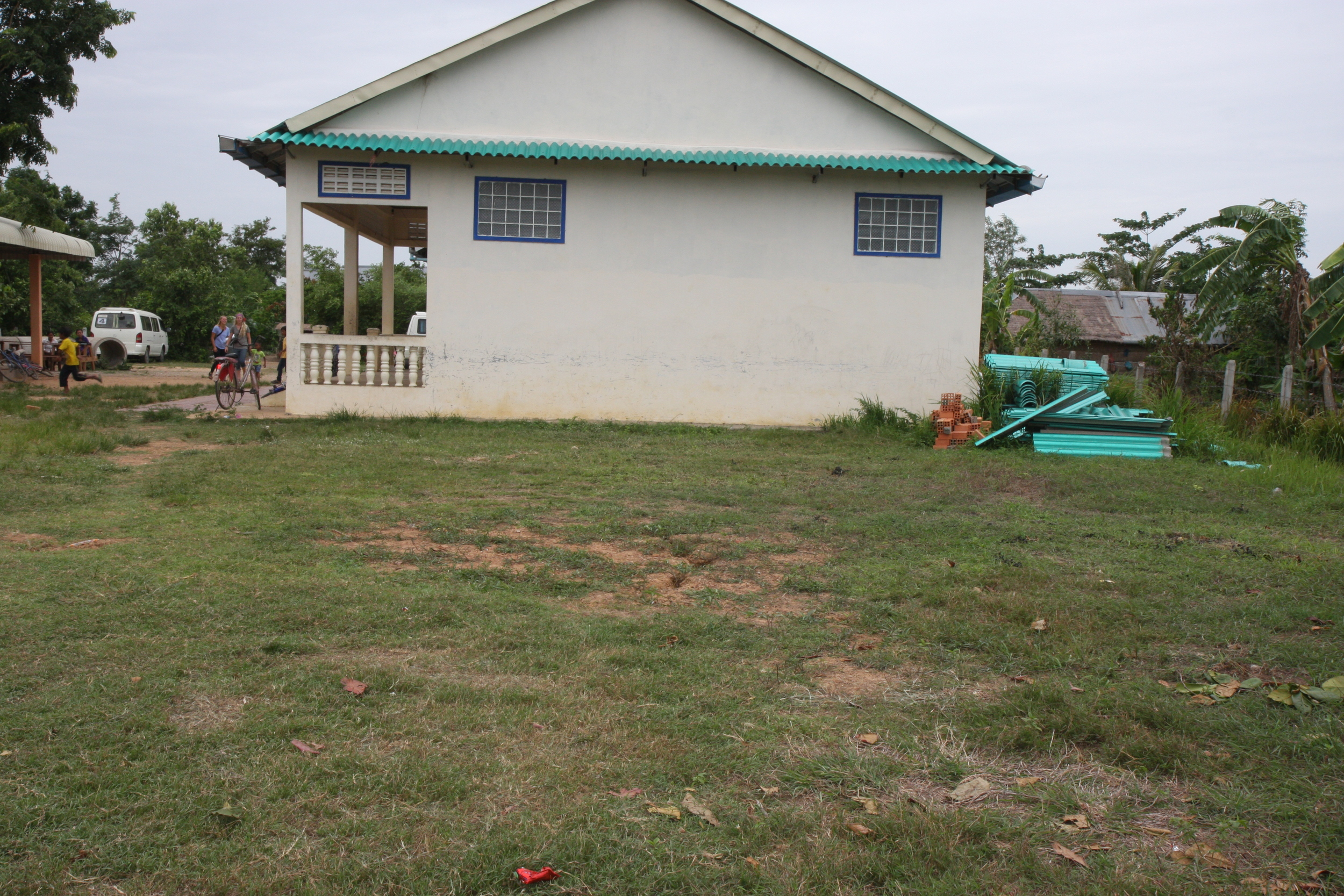 The school wall that will become a screen tonight...and the cut grass where we will sit and enjoy the evening with our village friends...