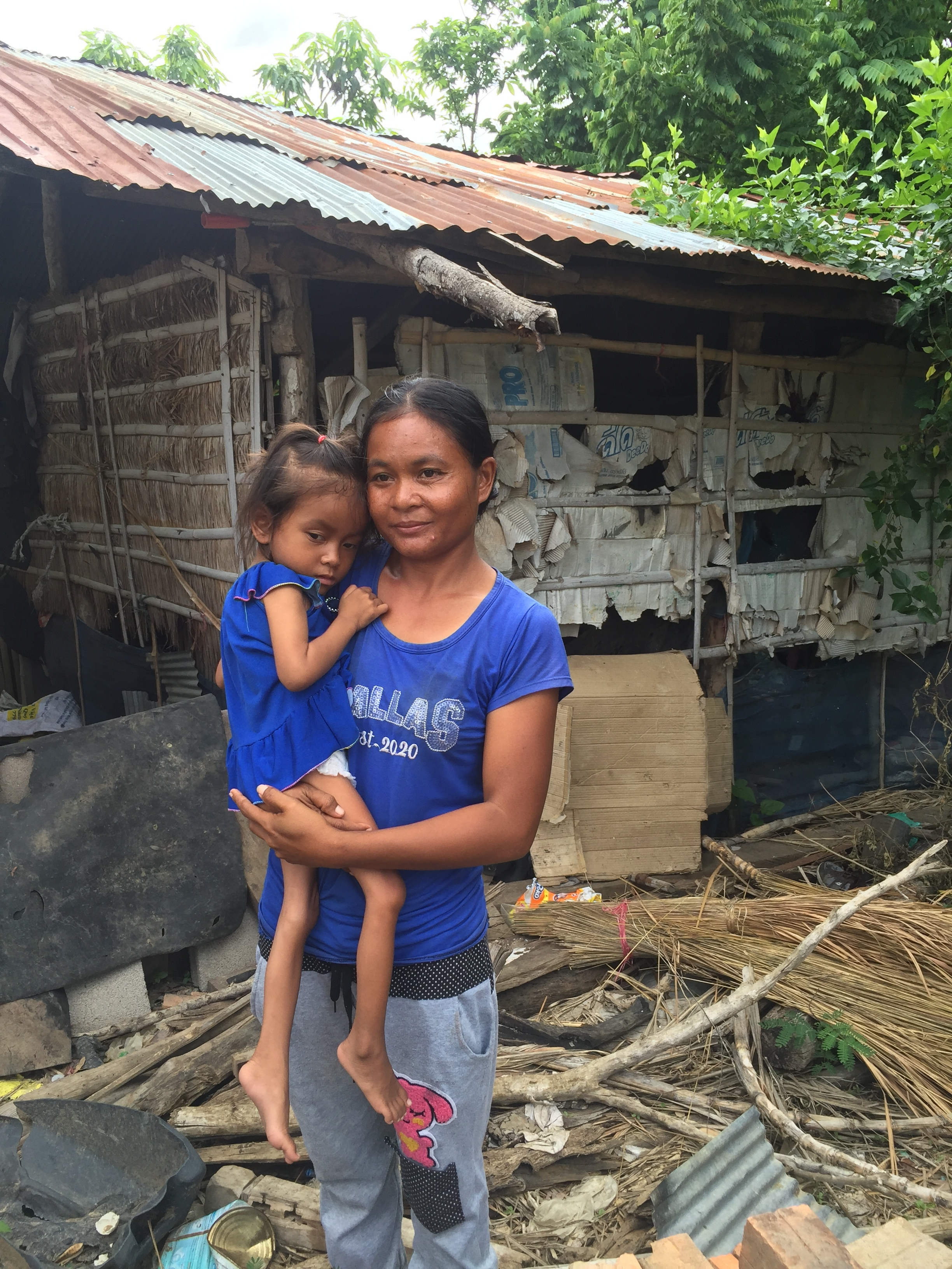Pai and Ganya in front of their hut.