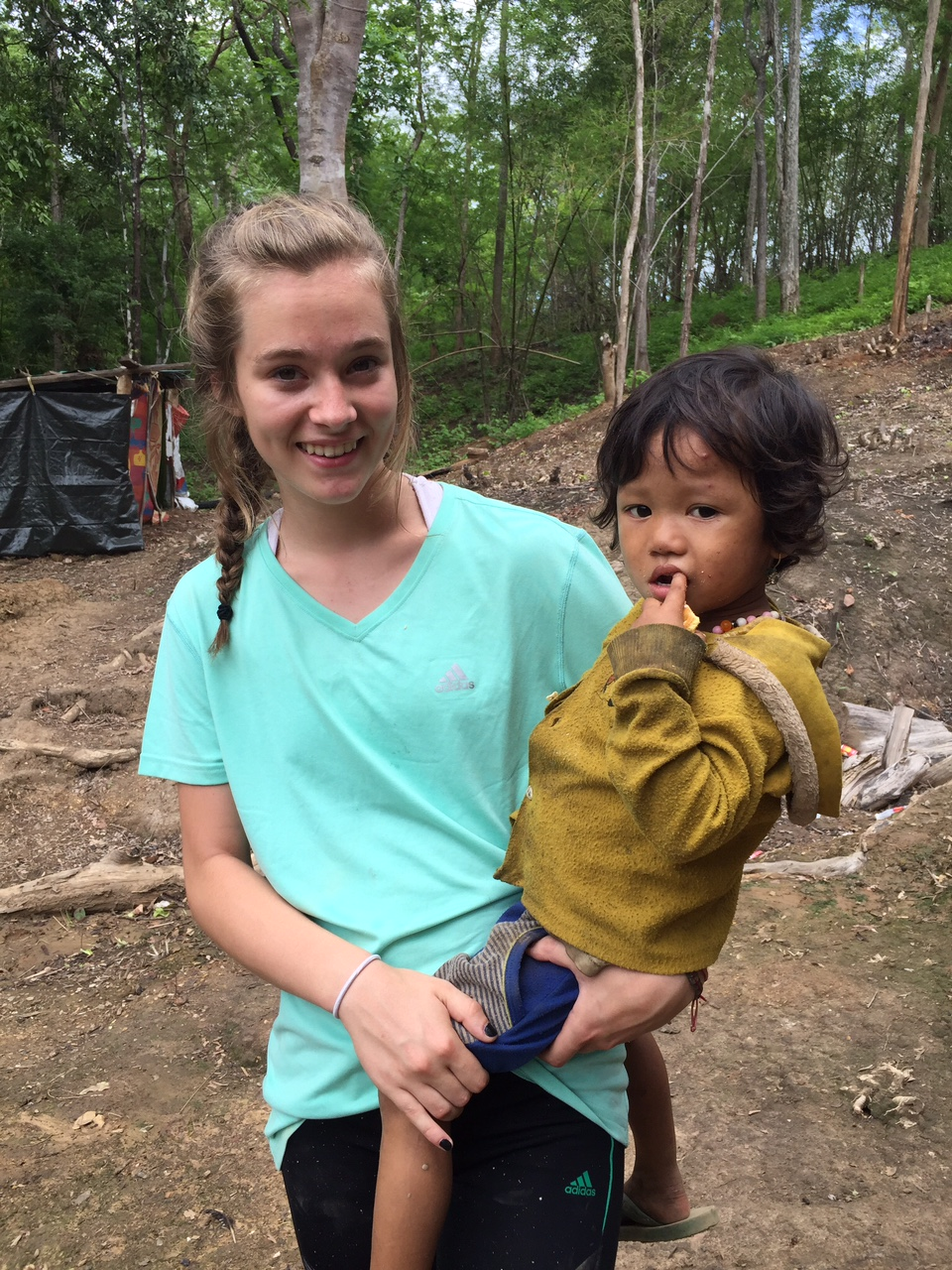 Jordan holding one of the sweet children from the nearest village in Burma before the attacks