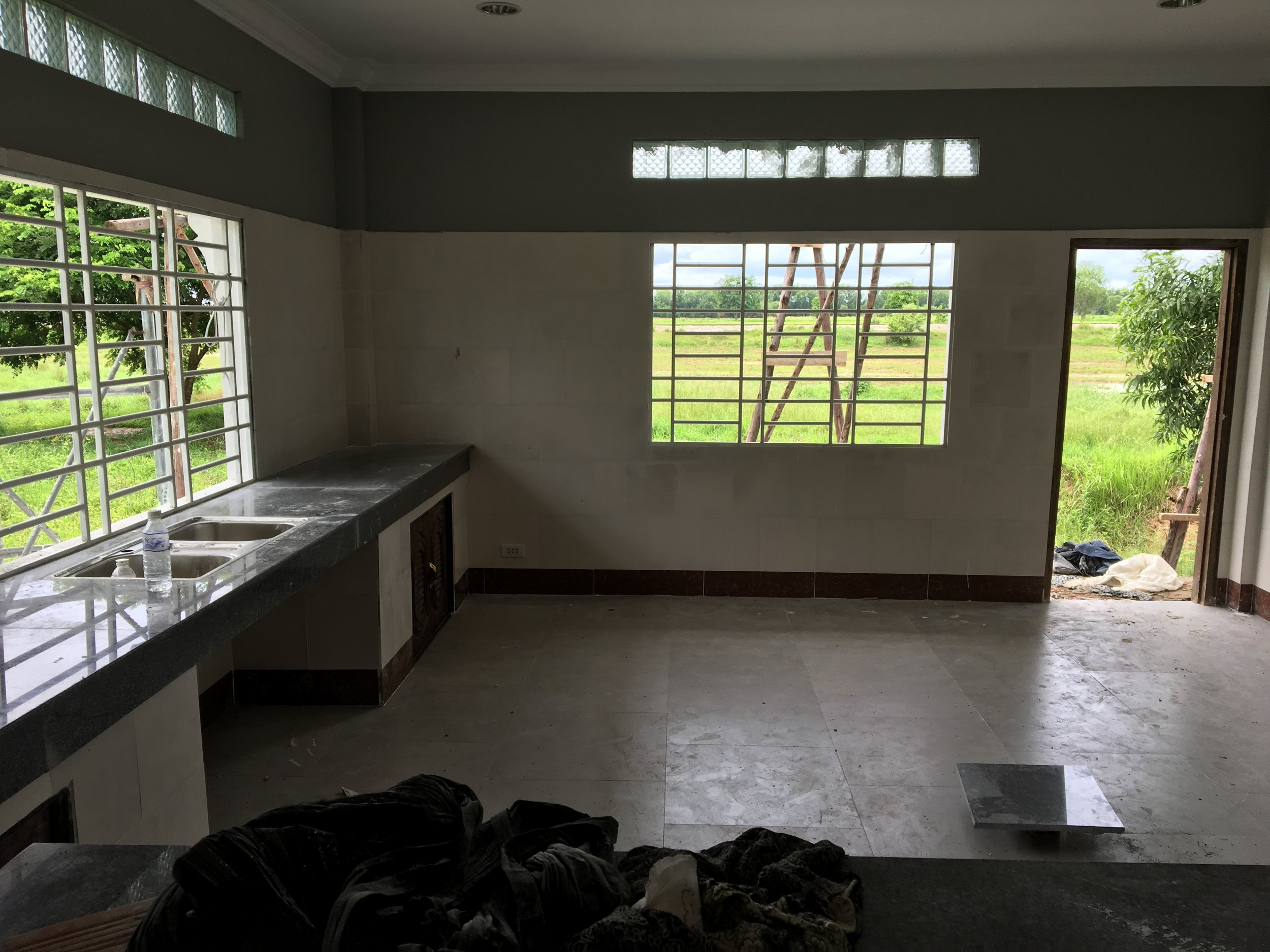 The Kitchen...waiting on a faucet, windows and door...